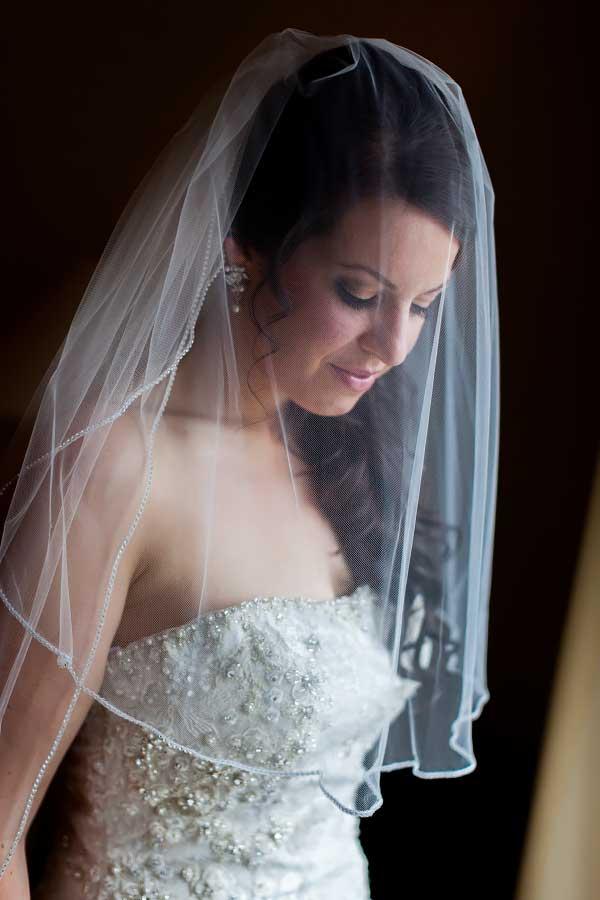 A Bride With Veil in Hotel Room